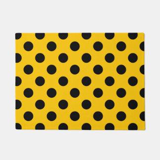 Black polka dots on yellow doormat