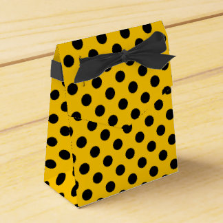 Black polka dots on yellow party favor boxes