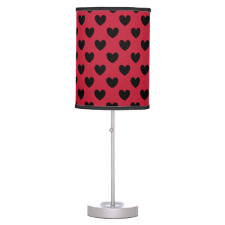 Black polka hearts on red table lamp
