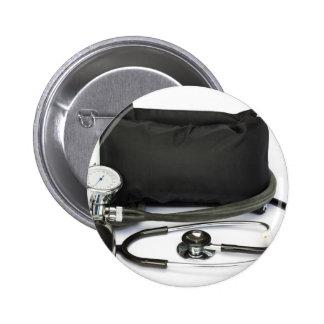 Black professional blood pressure monitor on white 2 inch round button