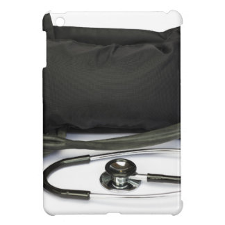 Black professional blood pressure monitor on white cover for the iPad mini