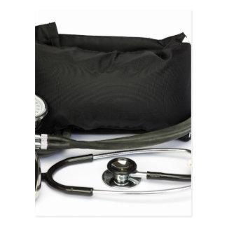 Black professional blood pressure monitor on white postcard