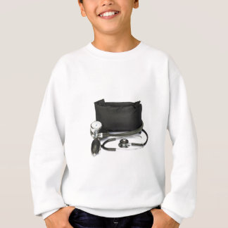 Black professional blood pressure monitor on white sweatshirt
