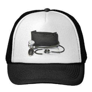 Black professional blood pressure monitor on white trucker hat