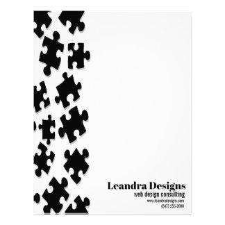 black puzzle pieces letterhead