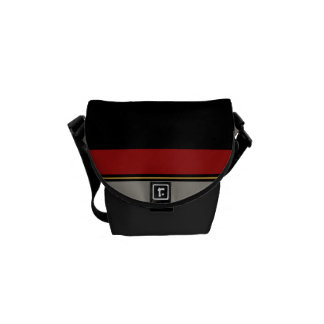 Black, red, gray, tan messenger bag
