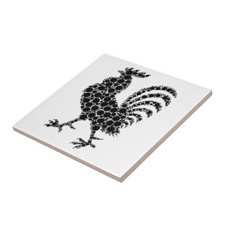 Black rooster on white ceramic tile