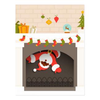 black santa stuck in fireplace postcard