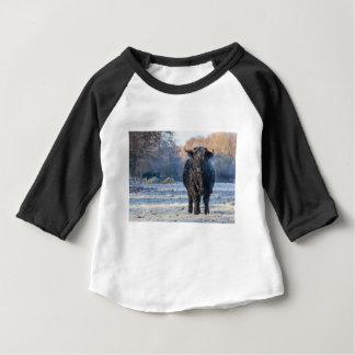 Black scottish highlander cow in winter landscape baby T-Shirt