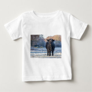 Black scottish highlander cow in winter landscape baby T-Shirt