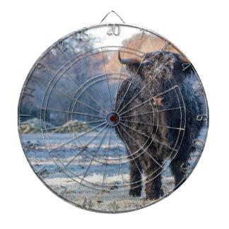 Black scottish highlander cow in winter landscape dartboard