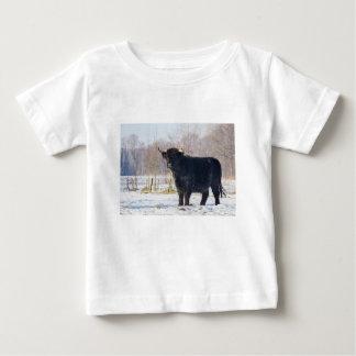 Black scottish highlander cow in winter snow baby T-Shirt
