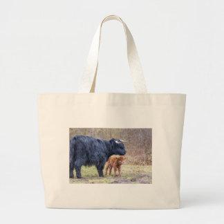 Black Scottish highlander mother cow with newborn Large Tote Bag