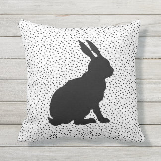 Black Silhouette Sitting Rabbit on Black Dots Outdoor Pillow