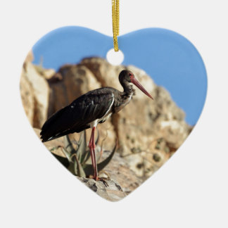 Black stork (Ciconia nigra) on a rock. Ceramic Ornament