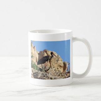 Black stork (Ciconia nigra) on a rock. Coffee Mug