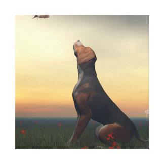 Black tan dog looking a bird flying canvas print