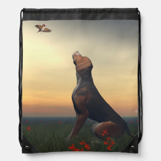 Black tan dog looking a bird flying drawstring bag