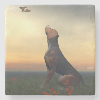 Black tan dog looking a bird flying stone coaster