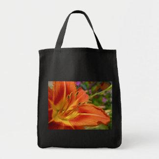 Black tote with orange flower