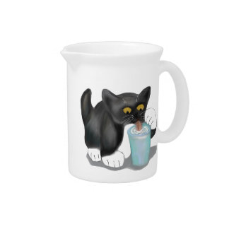 Black Tuxedo Kitten Sneaks a Glass of Milk Pitcher