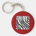 Black Zebra Print Pattern on Deep Red. Keychains