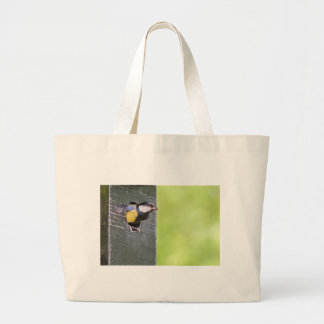Blackbird parent in hole of nest box large tote bag