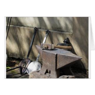 Blacksmith hammer resting on the anvil card