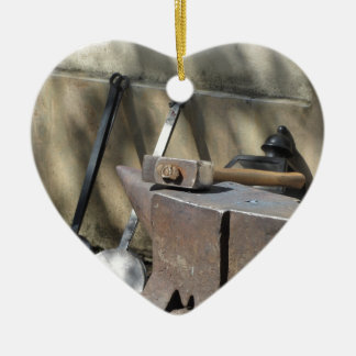 Blacksmith hammer resting on the anvil ceramic heart ornament