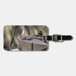Blacksmith hammer resting on the anvil luggage tag