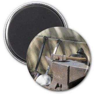 Blacksmith hammer resting on the anvil magnet