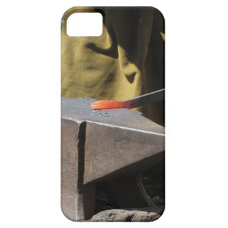 Blacksmith manually forging the molten metal case for the iPhone 5