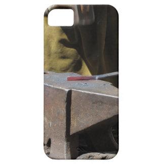 Blacksmith manually forging the molten metal iPhone 5 case