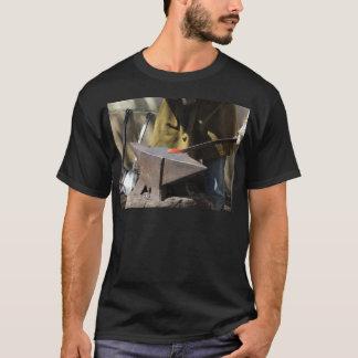 Blacksmith manually forging the molten metal T-Shirt