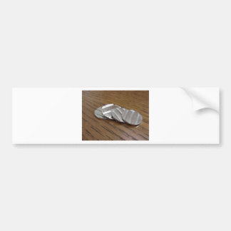 Blank metallic coins on wooden table bumper sticker