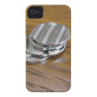 Blank metallic coins on wooden table Case-Mate iPhone 4 case