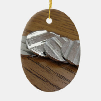 Blank metallic coins on wooden table ceramic ornament