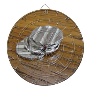 Blank metallic coins on wooden table dartboards