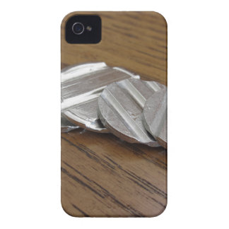 Blank metallic coins on wooden table iPhone 4 Case-Mate case