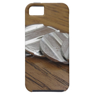 Blank metallic coins on wooden table iPhone 5 case