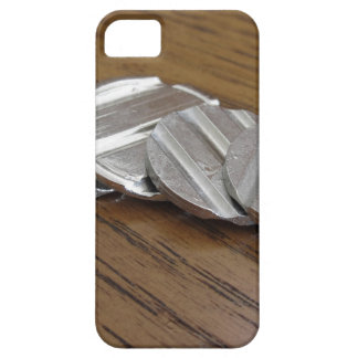Blank metallic coins on wooden table iPhone 5 cases