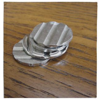 Blank metallic coins on wooden table printed napkin