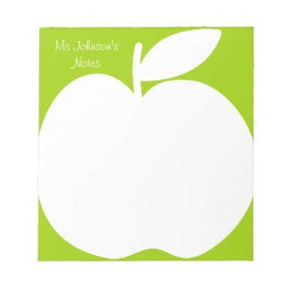 Blocs-notes vert pomme d'écriture pour le maître d