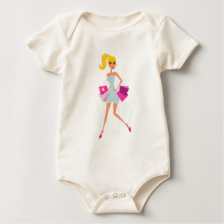 Blond model girl with dots and pink baby bodysuit