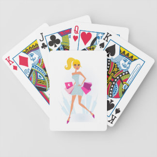 Blond model girl with dots and pink bicycle playing cards