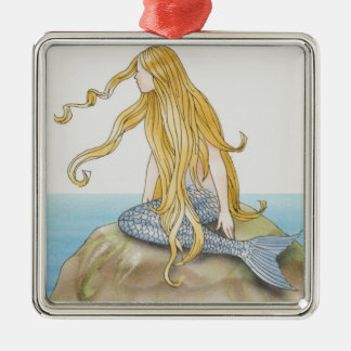 Blonde mermaid sitting on sea rock, side view. metal ornament
