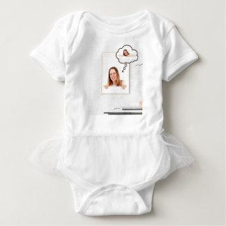 Blonde Woman Thinking on White Board Baby Bodysuit