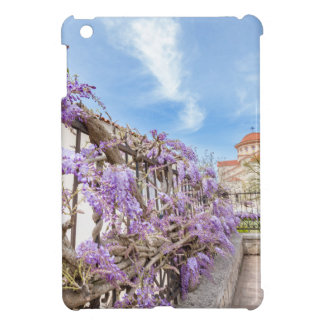 Blooming blue Wisteria sinensis on fence in Greece Cover For The iPad Mini
