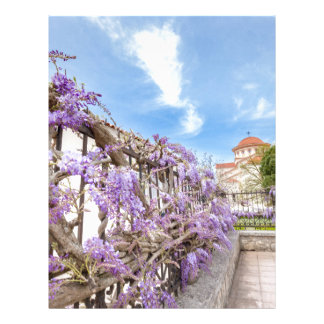 Blooming blue Wisteria sinensis on fence in Greece Letterhead