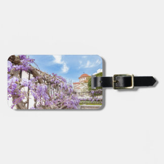 Blooming blue Wisteria sinensis on fence in Greece Luggage Tag